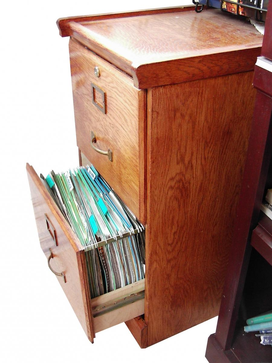 A wooden Filing Cabinet with drawer open