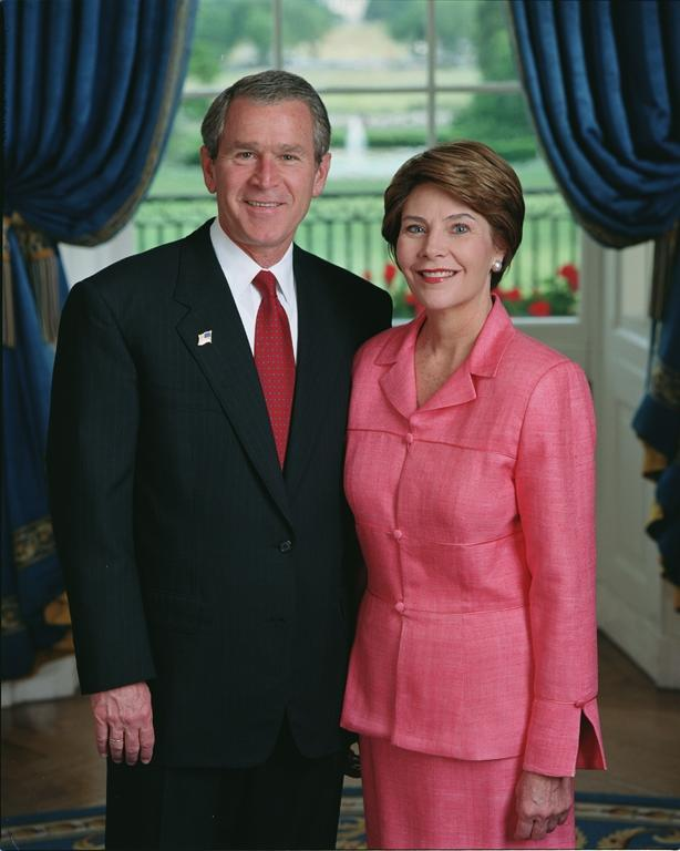 President George W. Bush and Mrs. Laura Bush stand in the Blue...