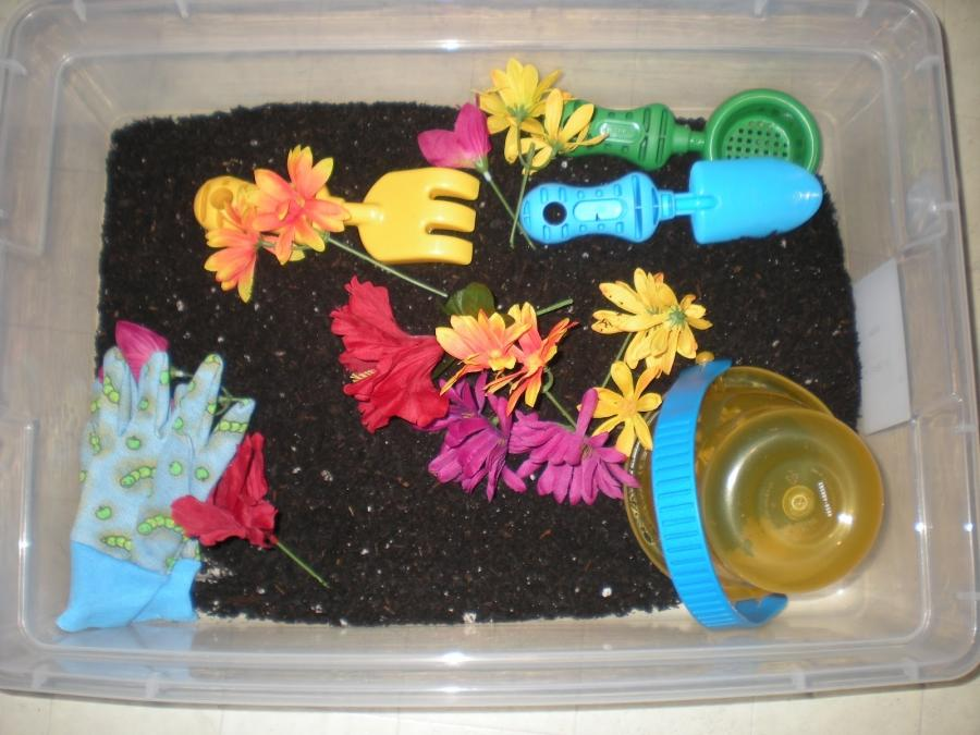 For this tub, I threw in a bag of soil and added silk flowers, a...