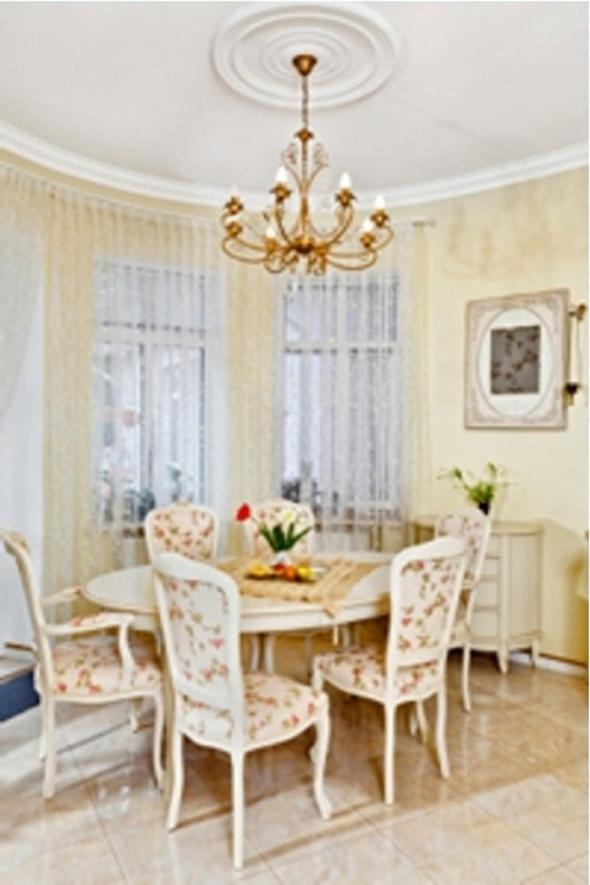 cottage style dining room interior in white and pale colors