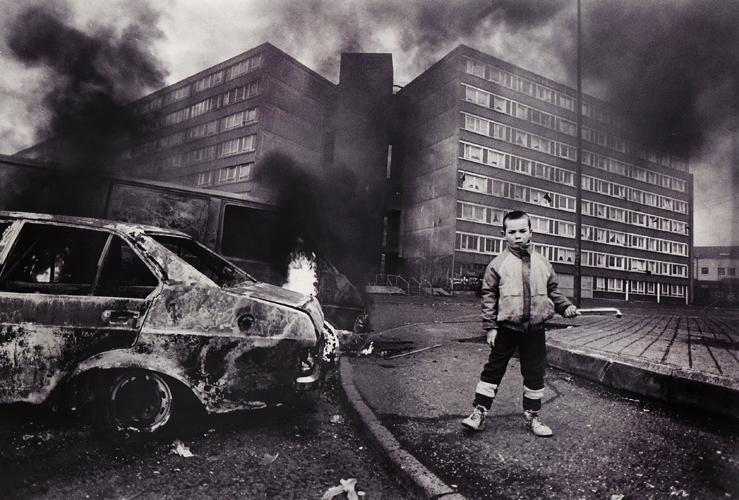 The Troubles : Child with Burning Cars Divis Flats : Belfast :...