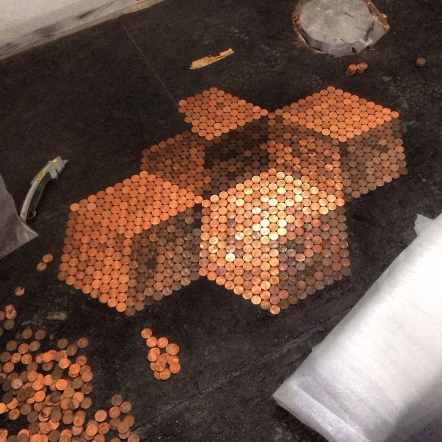 Using pennies to tile my bathroom floor. Hereu what I have so...