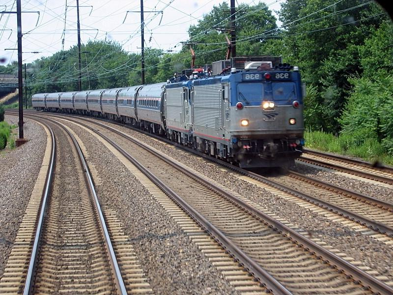 An electric Amtrak train with two AEM-7 locomotives running...