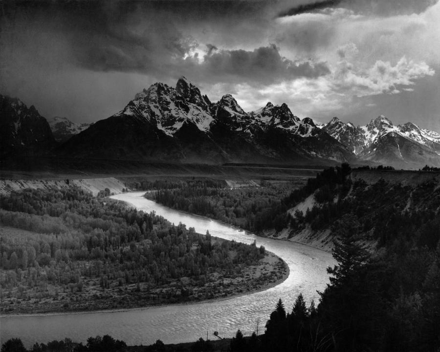A dramatically-lit black-and-white photograph depicts a large...