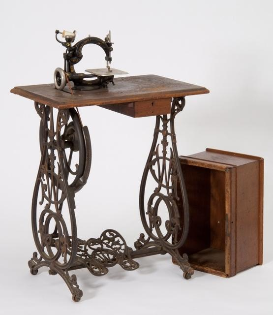 Willcox and Gibbs treadle base. I love how the irons are so...