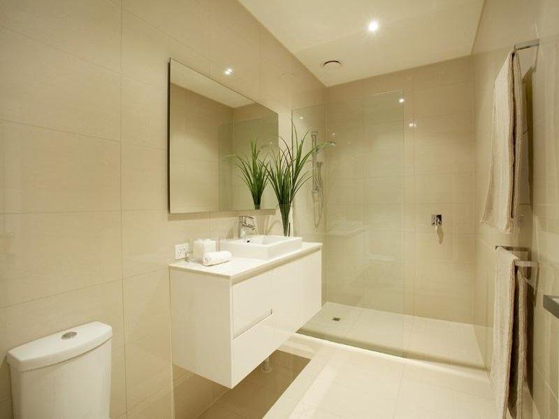 Country bathroom design with corner bath using tiles - Bathroom...