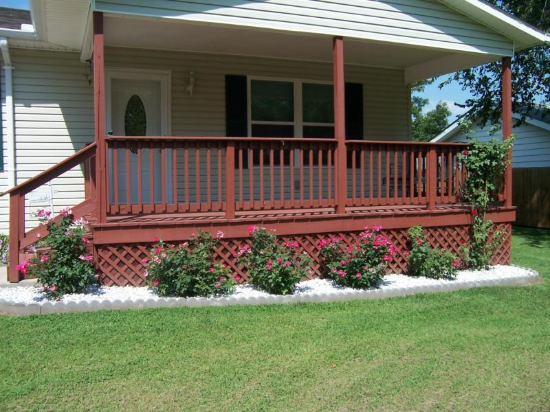 Beautifully landscaped yard with covered front porch.