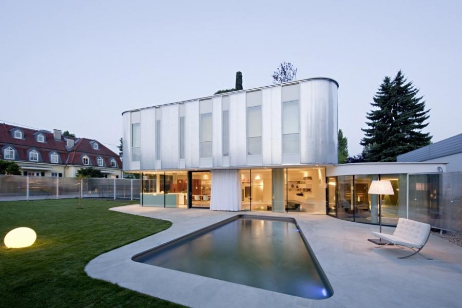 According the architects: Curved house design for a family with...
