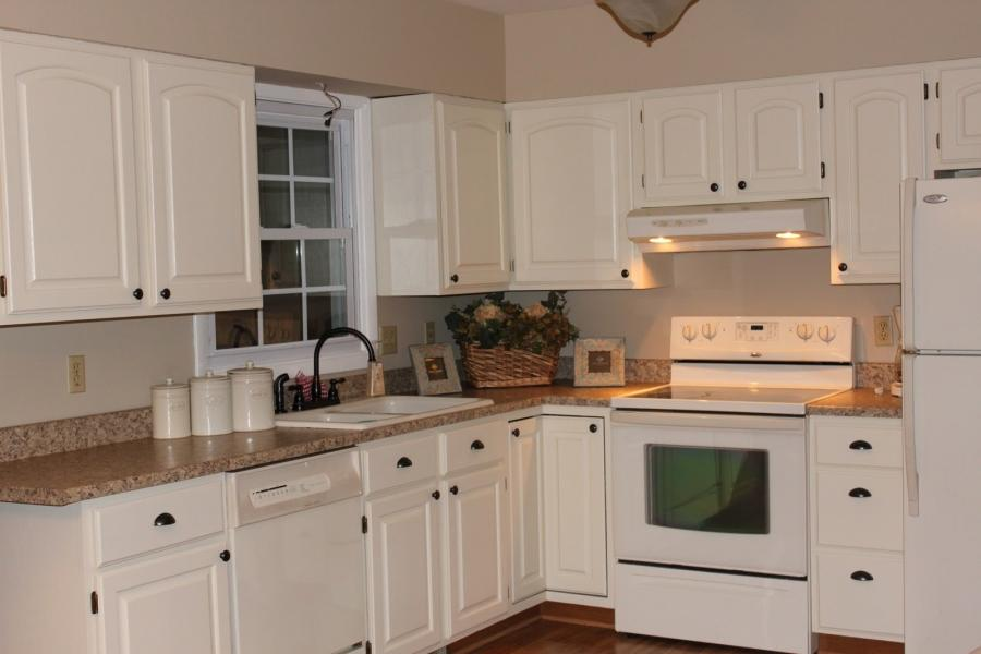 Photos of kitchens with cream cabinets