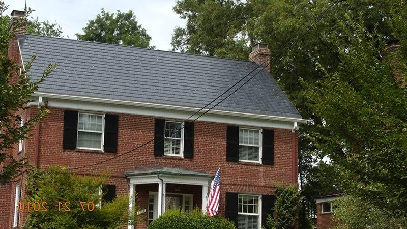 Brick homes with metal roofing photos for Red brick house with metal roof