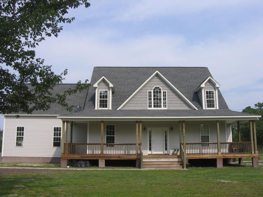 This 4 BR (with bonus room)/2.5 bath home has a perfect country...