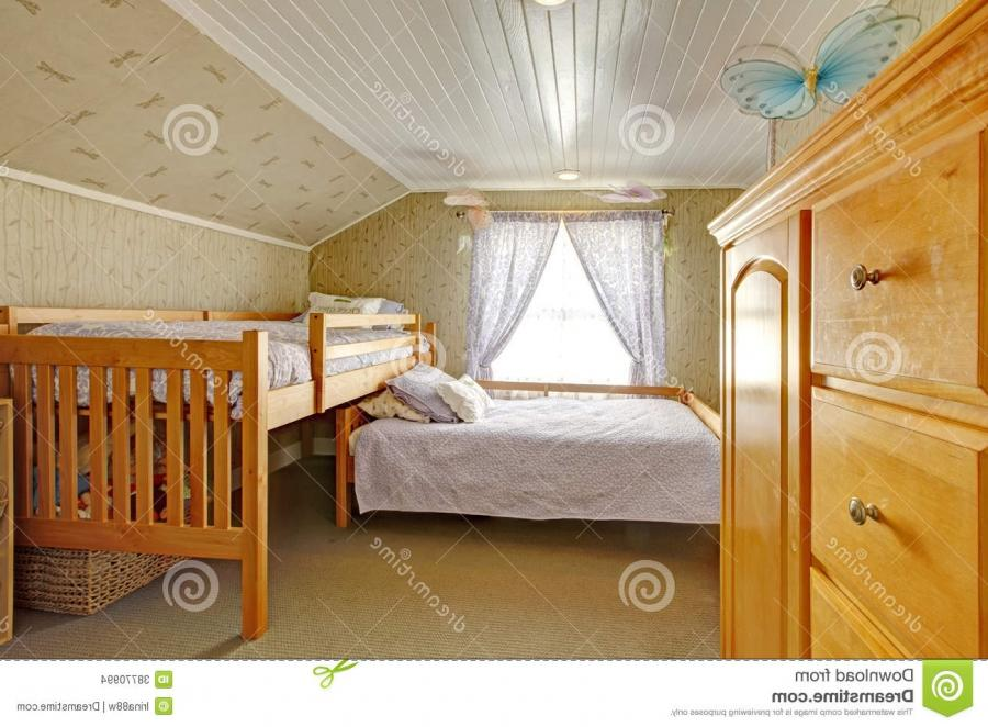 Vaulted Ceiling Bedroom With Low And High Beds Stock Images .