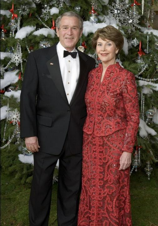 President George W. Bush and Mrs. Laura Bush pose for a holiday...