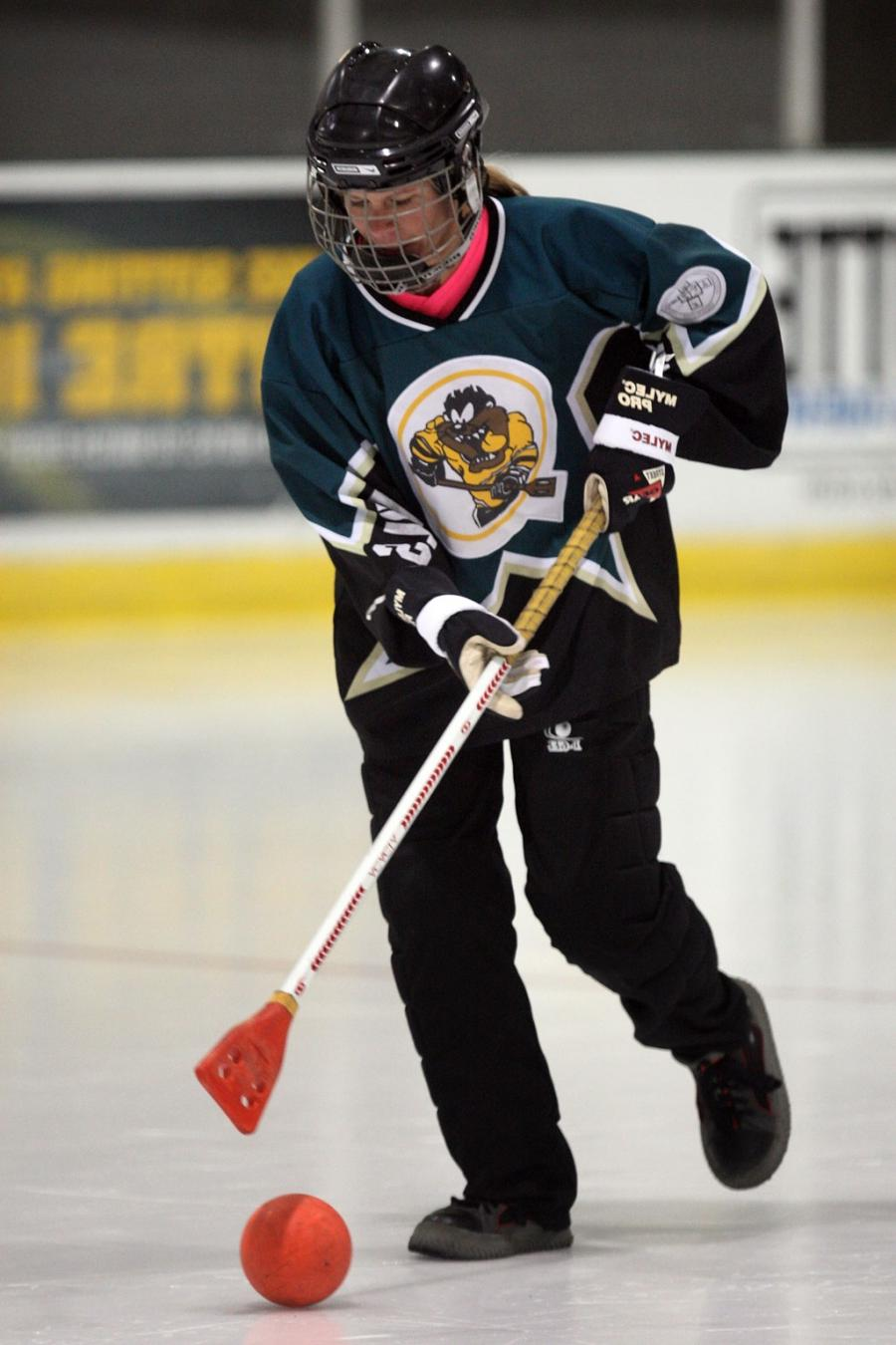 Kelly concentrates on carrying the ball down the ice. (NICK...