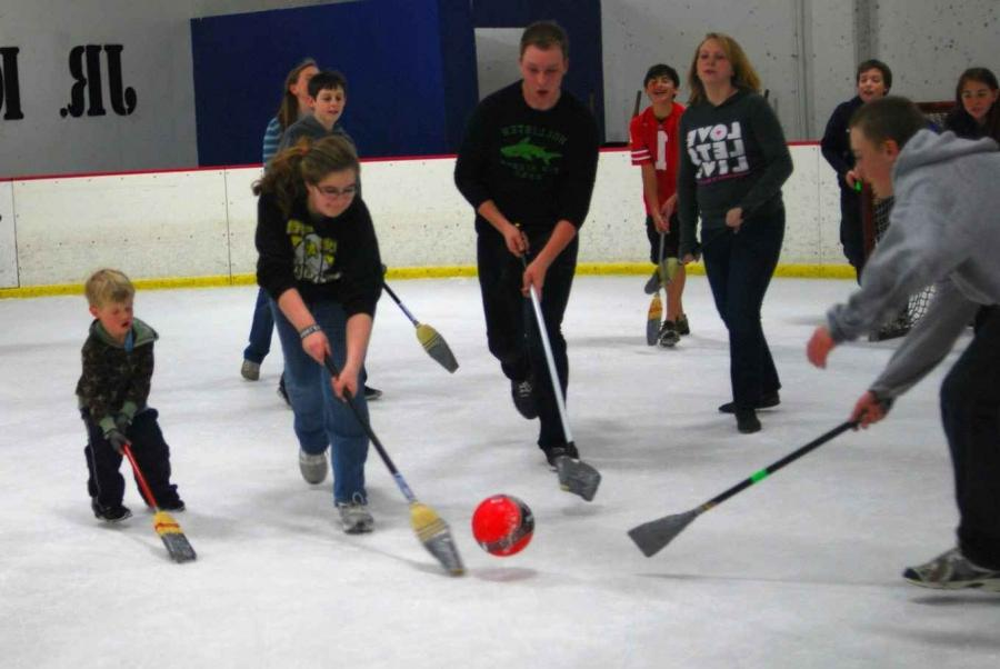 Broomball is a sport played with an actual broom that is taped up...