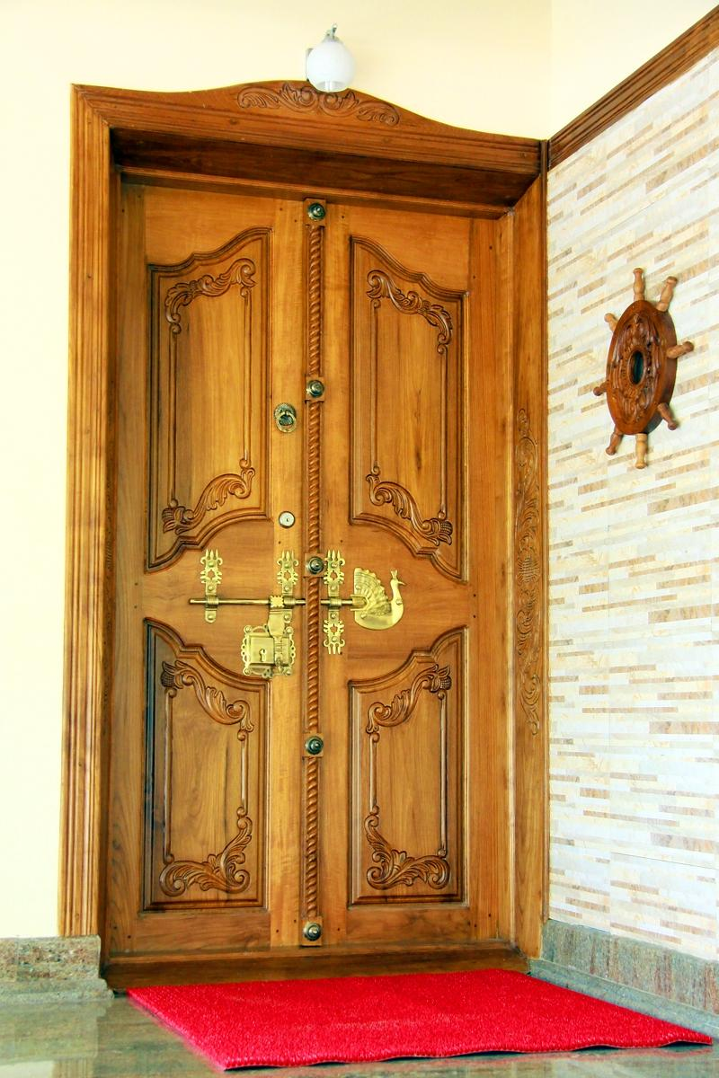 Door designs photos kerala for Traditional wooden door design ideas