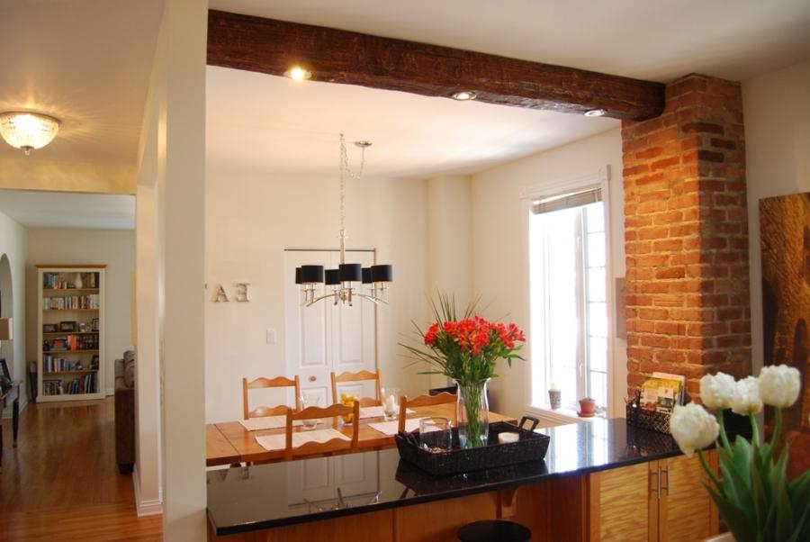 One faux wood ceiling beam completes this beautiful dining room...