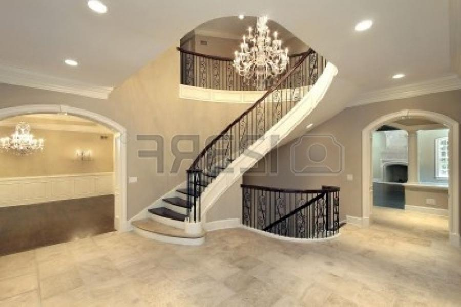 Foyer with curved stairway in new construction home