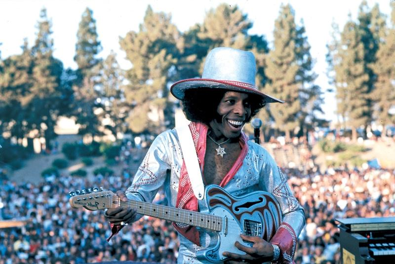Featured Photo. Sly Stone With Guitar
