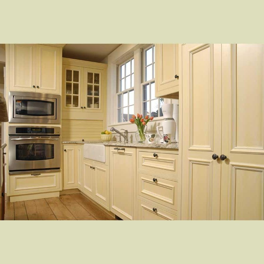 Photos cream colored kitchen cabinets for Solid wood kitchen cabinets