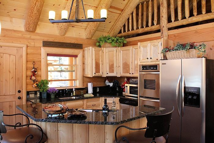 Granite is another very popular choice for log home kitchens. It...